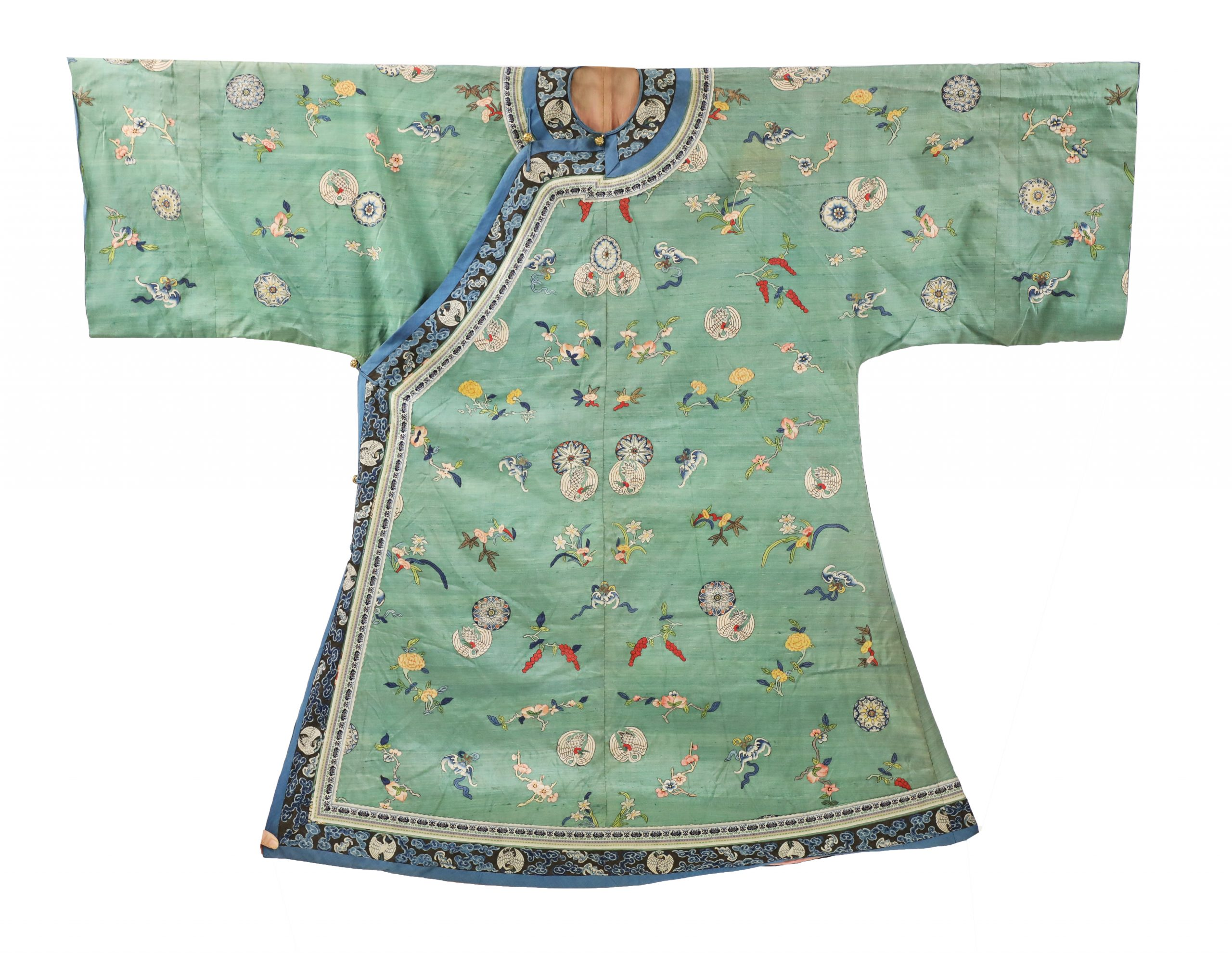 Decorated with crane roundels, sprigs of flowers, lingzhi, bats and peaches, against a green ground, a black border continuing around the neckline to the hem and to the sleeves, decorated with crane roundels among clouds, 155cm across the arms 121.5cm long approximately 清 缂丝绿地折枝花卉纹氅衣