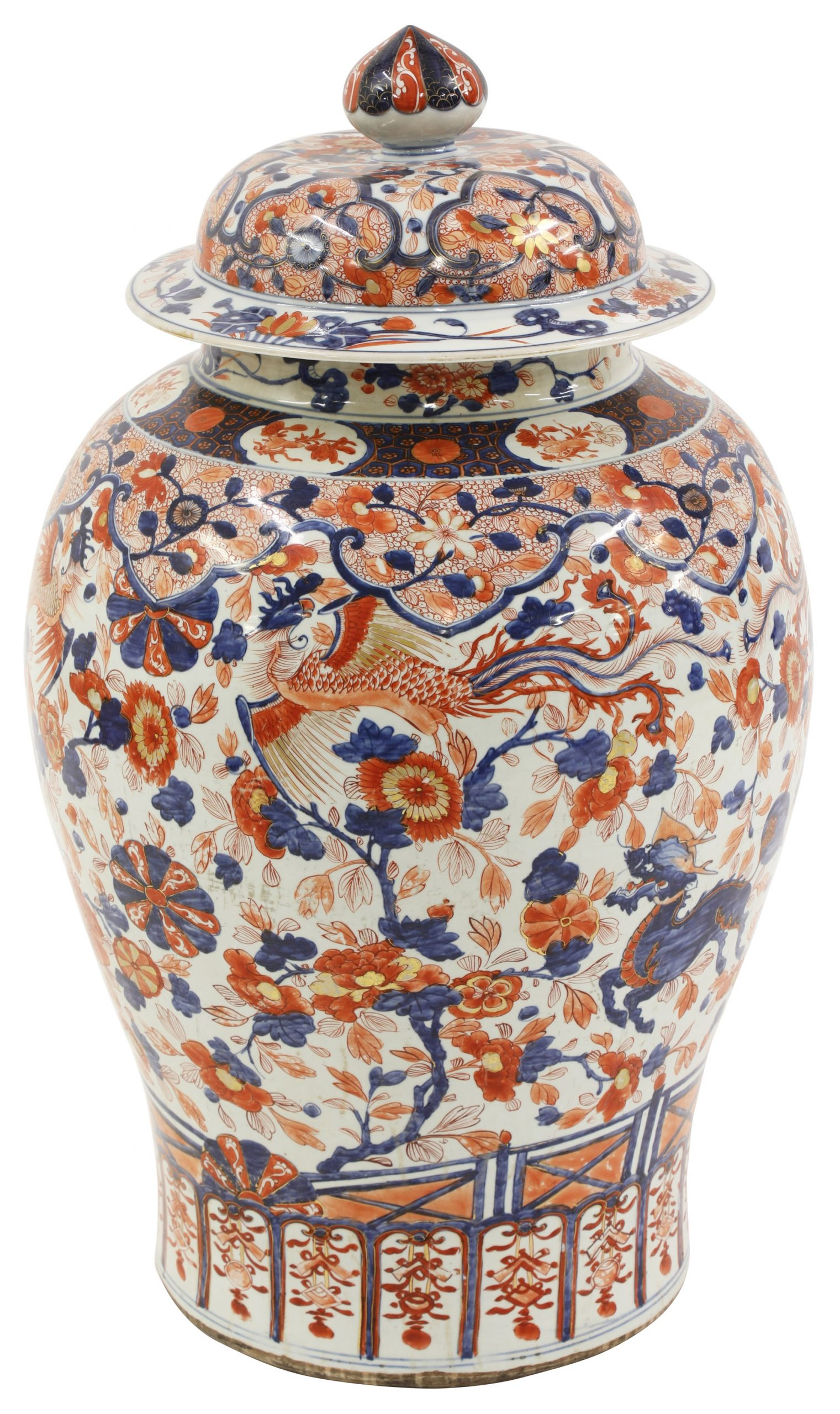 Of baluster form, painted with phoenixes and qilin among foliage in a garden, between a ruyi-shaped border to the shoulder and upright petal lappets near the foot, 64cm high, and a matching Samson domed cover, 18th century, similarly decorated with a spear finial, overall 80cm high (2) 清康熙 伊万里式凤凰麒麟纹大罐 连十八世纪 法国Samson仿伊万里式盖