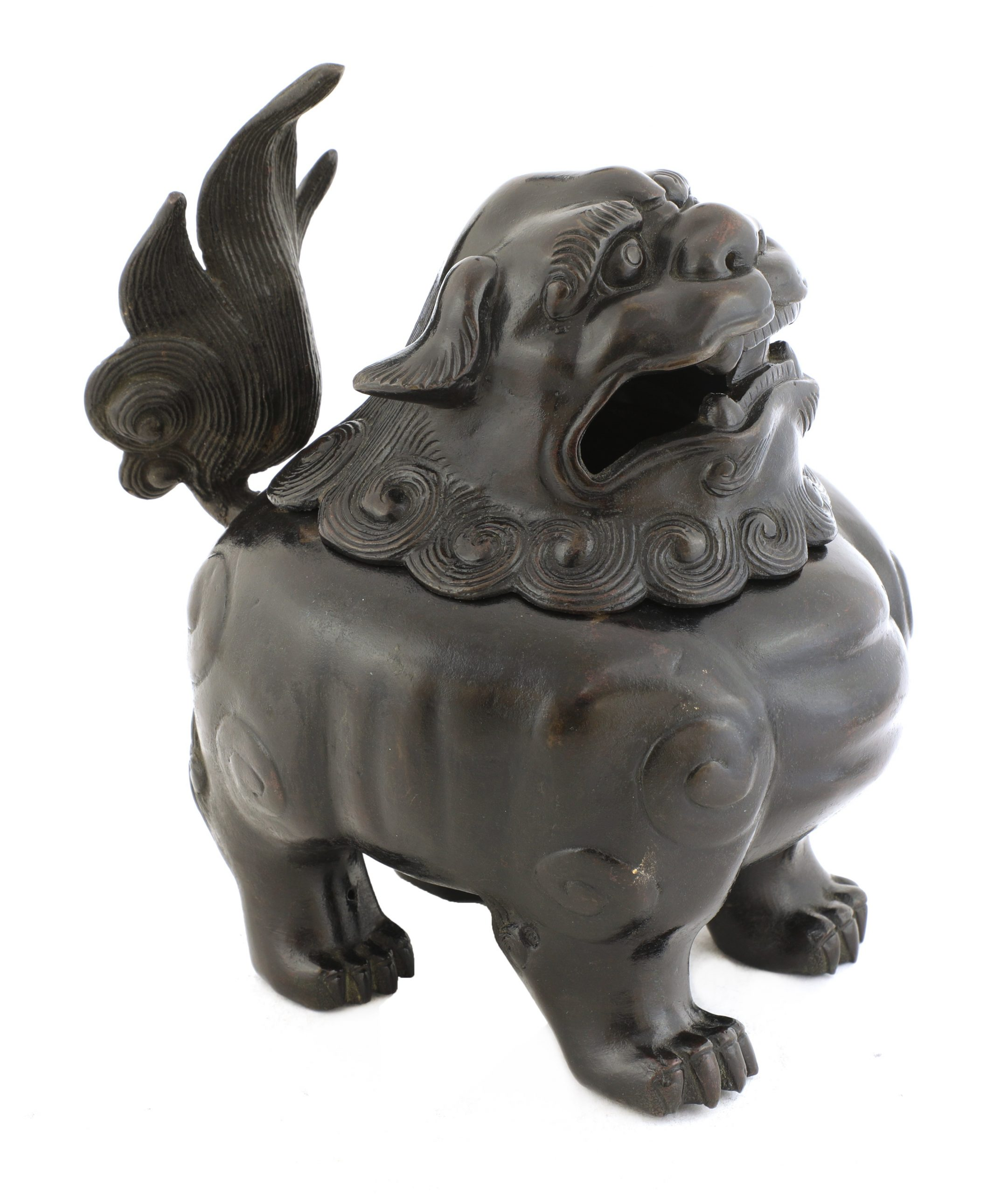 In the form of a standing Buddhist lion, the cover as the head, looking forward with open eyes, bushy eyebrows and open mouth, the body with an upright bushy tail, the feet well defined, 21.5cm high, 3100g (2) 十七世纪 铜铸佛狮香炉