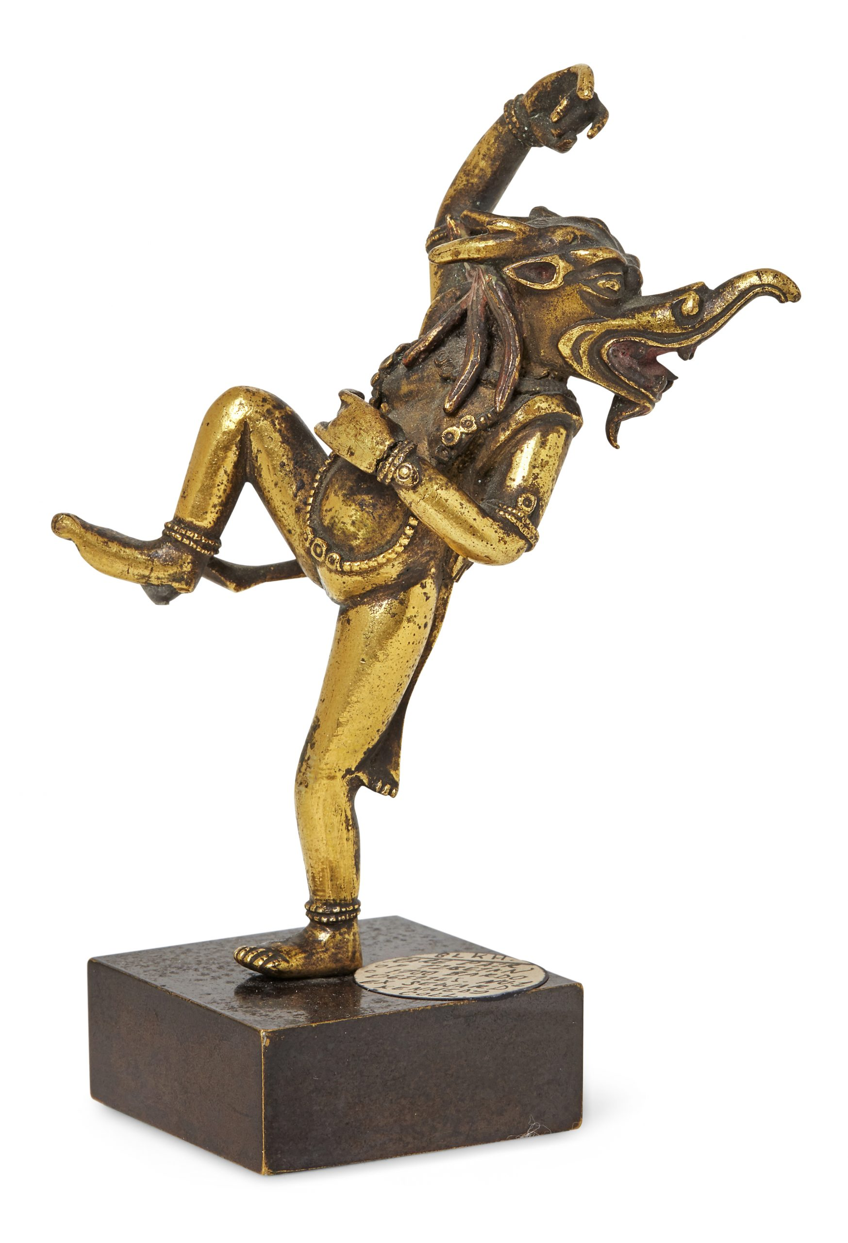 A Tibetan gilt-bronze bardo Makara-headed dancing deity, 17th century, 9cm high