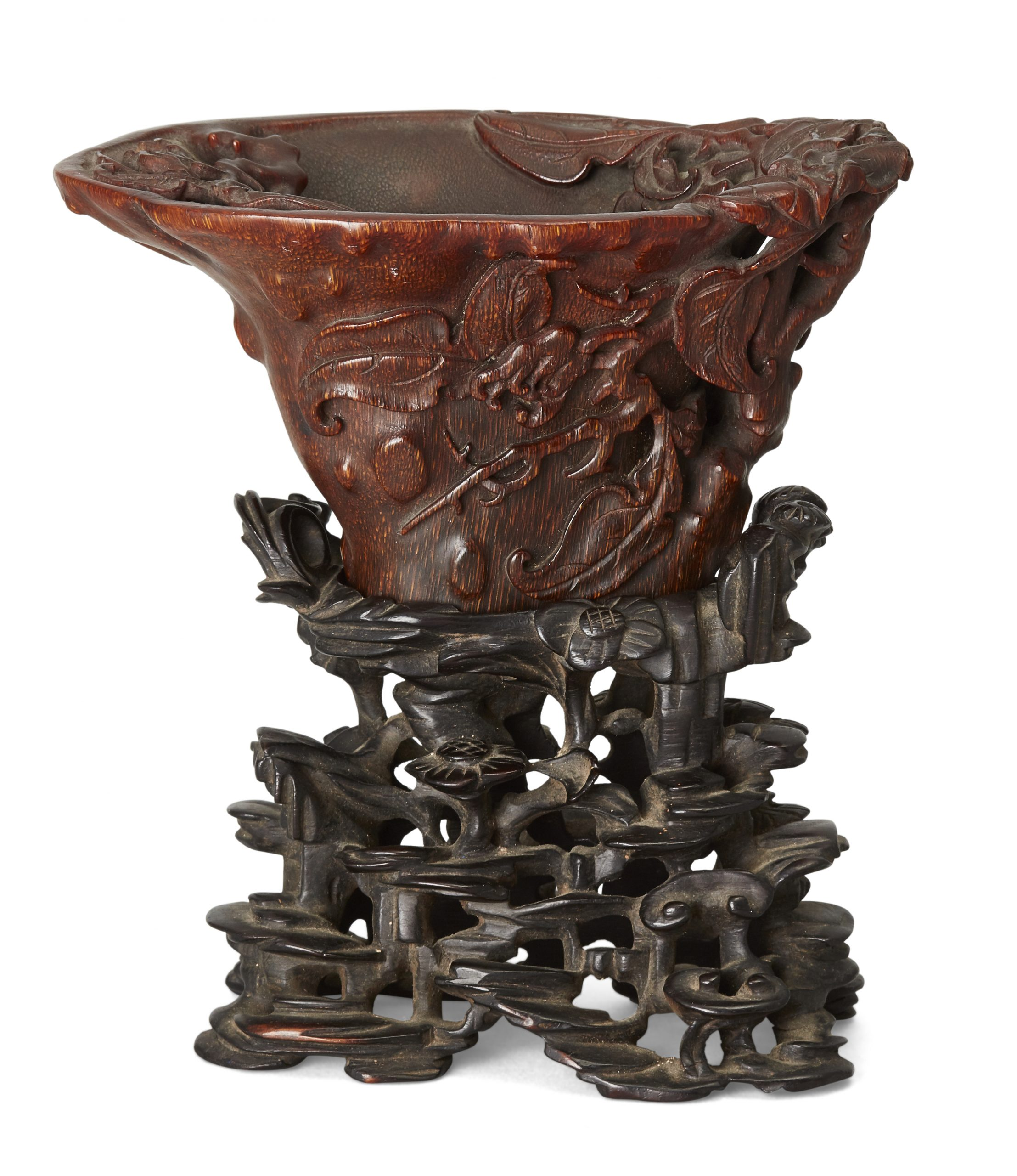 A rare Chinese rhinoceros horn 'Buddha's Hand' libation cup, 17th/18th century, 8cm high, on a finely carved fitted zitan stand
