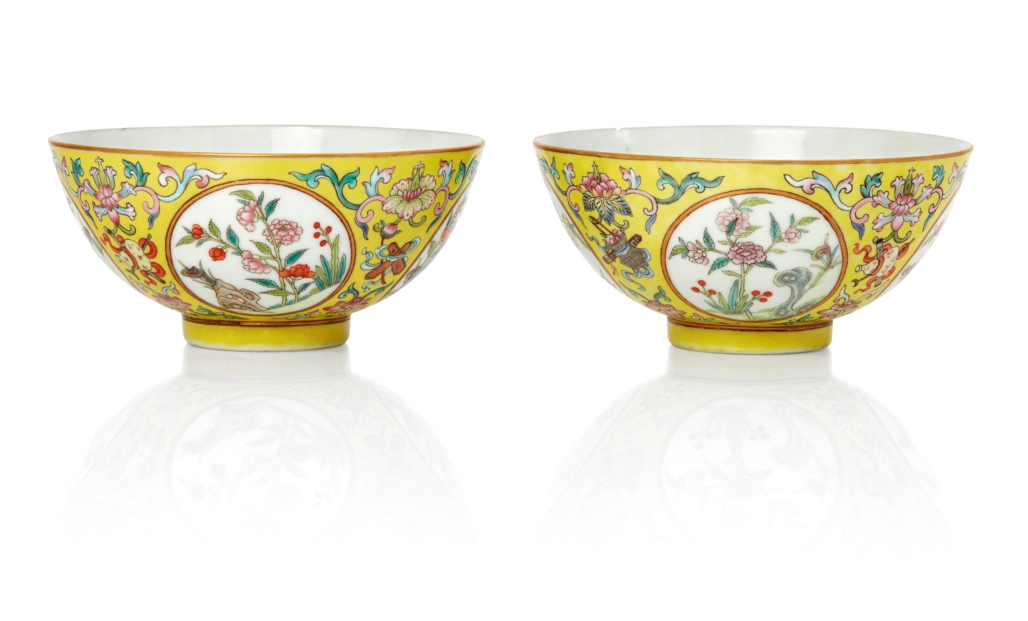 A pair of Chinese porcelain yellow-ground famille rose 'medallion' bowls, Daoguang period, circa 1831-1850