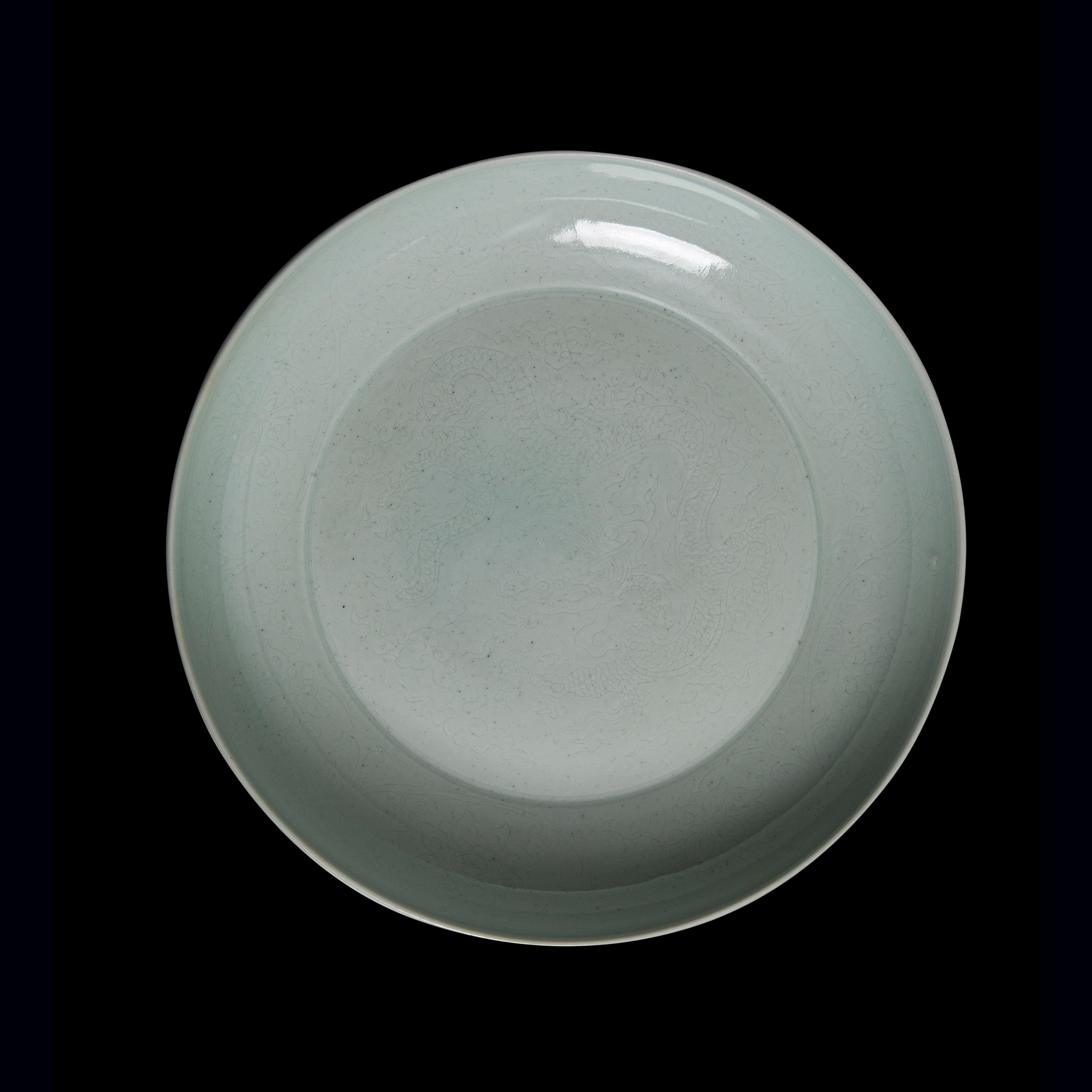 LARGE WHITE GLAZE 'DRAGON' CHARGER | POSSIBLY YONGZHENG PERIOD, Provenance: property of a gentleman; formerly from a private German collection, acquired from Beijing in 1965, thence by descent, 36.3cm diameter