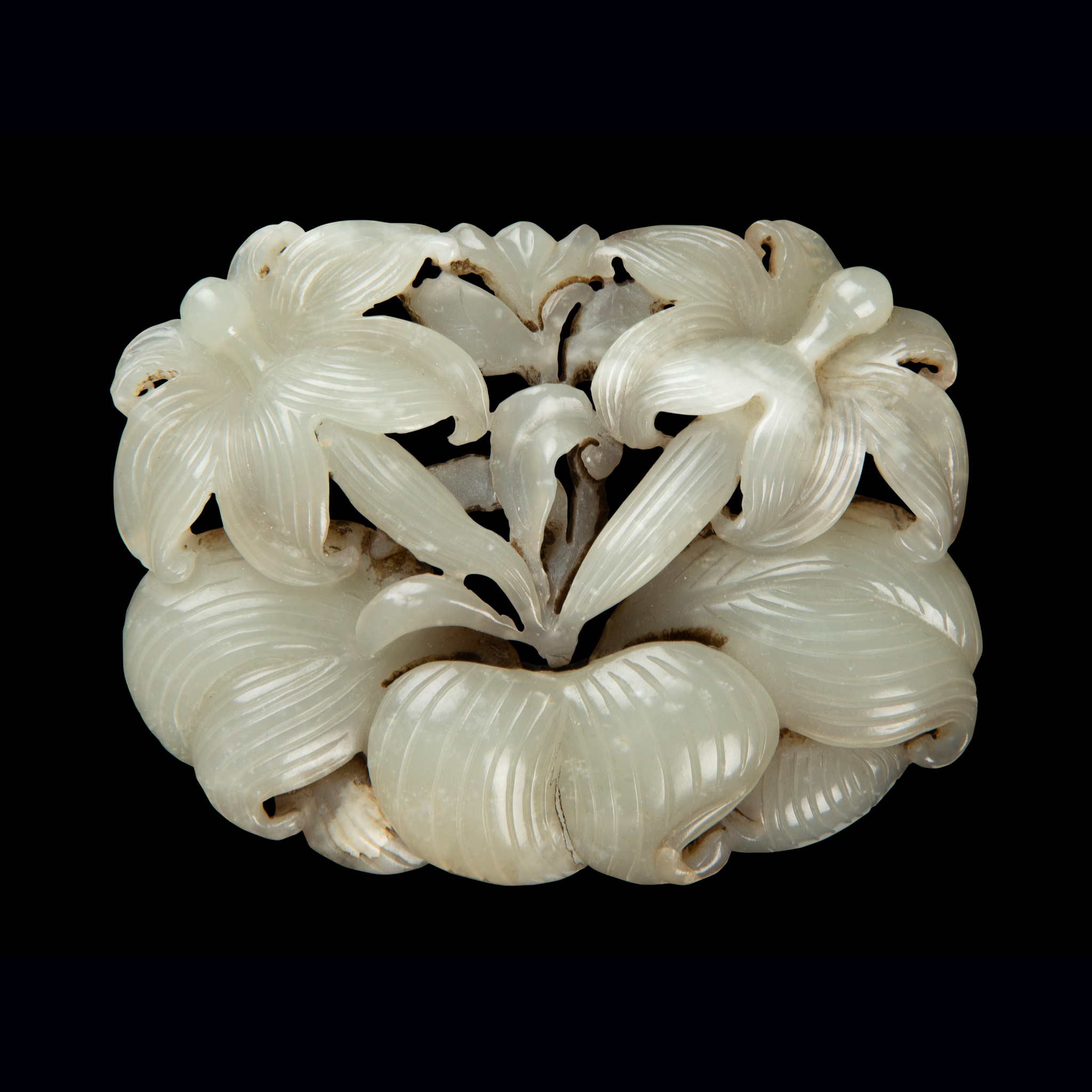RARE WHITE JADE 'DAYLILY' PENDANT | JIN DYNASTY, 12TH CENTURY, Provenance: Private English collection, acquired from UK market about 10 years ago; possibly sold to the UK market during the mid-20th century for earning foreign currency Note: a closely comparable example, dated to the Jin dynasty, is in the collection of the National Museum of China, 7.5cm wide