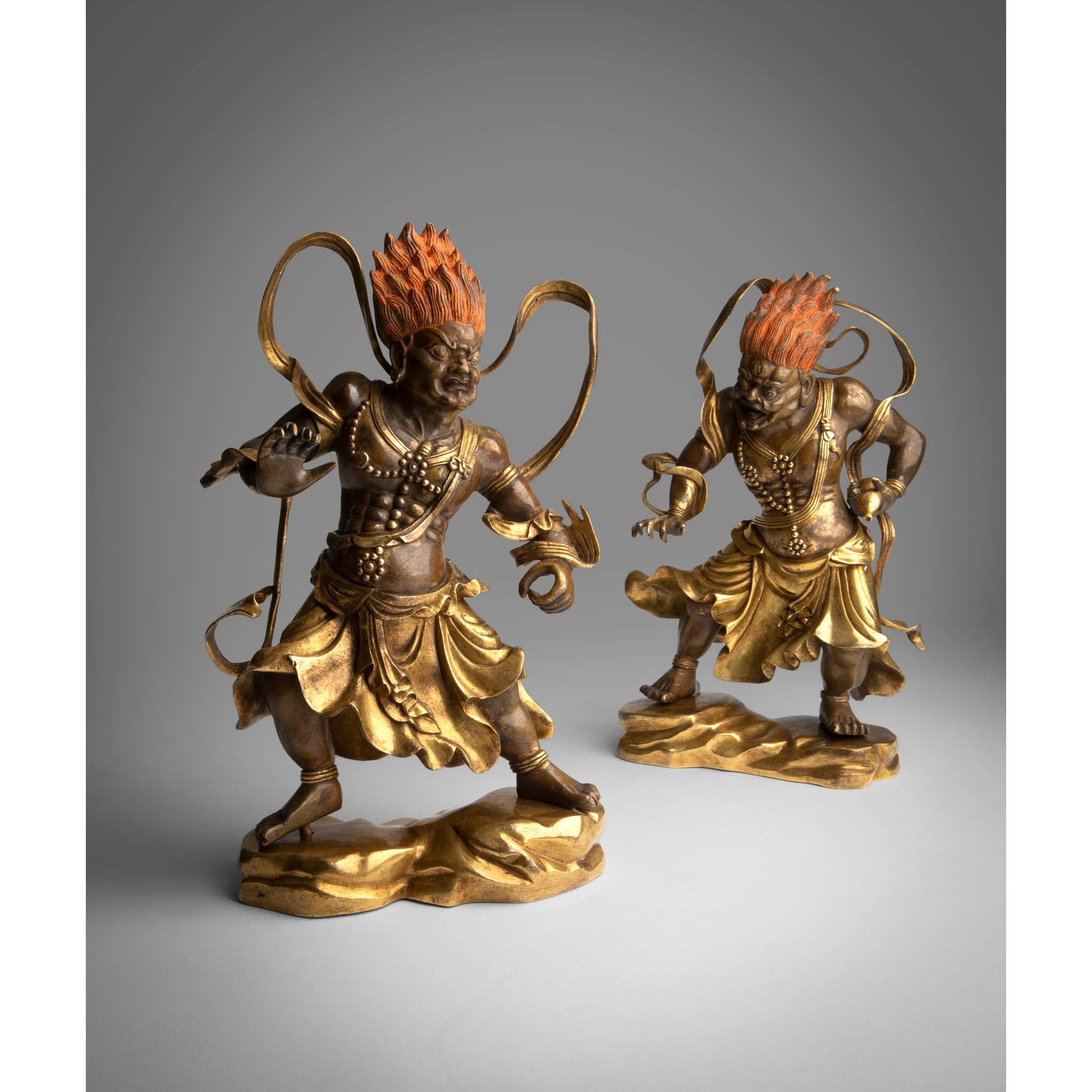PAIR OF GILT BRONZE FIGURE OF TEMPLE GUARDIANS | QING DYNASTY, 18TH CENTURY, Provenance: private German collection, 23cm high each; 26cm high with stand