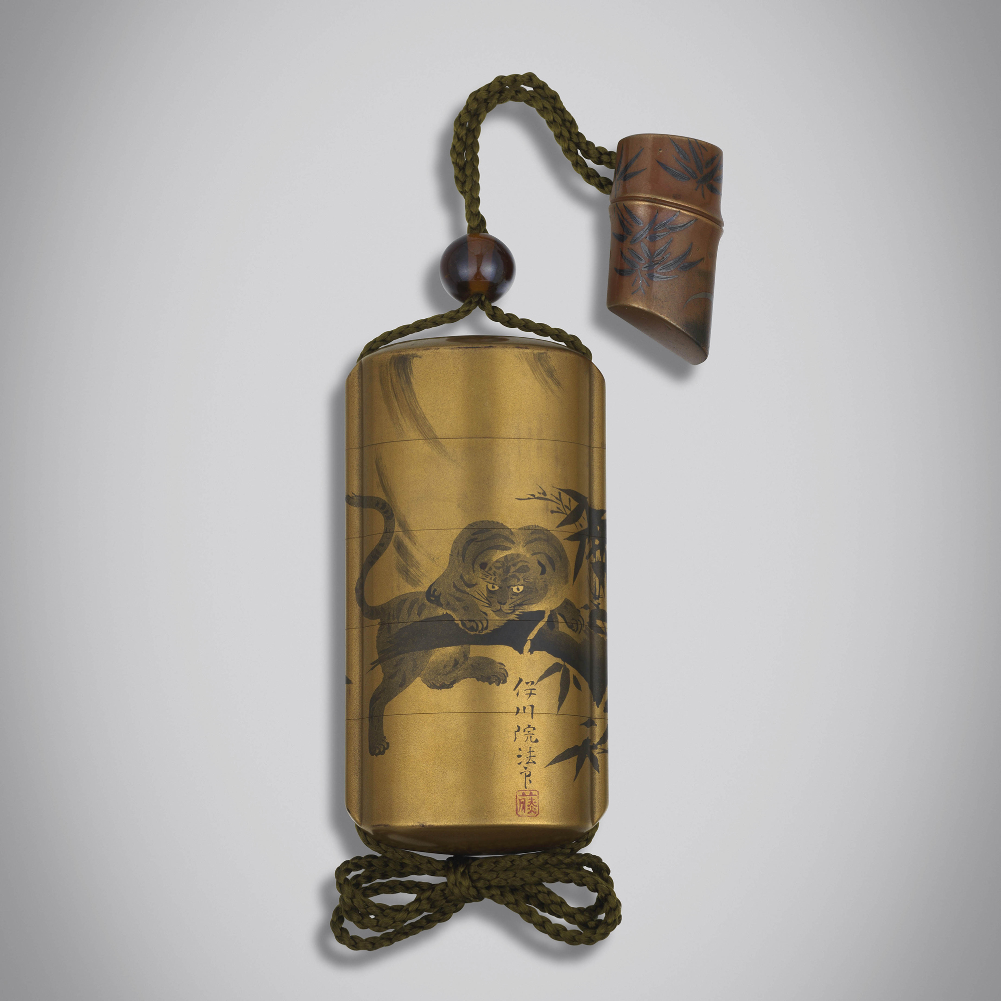 A gold lacquer inrō with tiger in a bamboo grove. Edo period, circa 1850. Height 9.5 cm Width 4.8 cm .