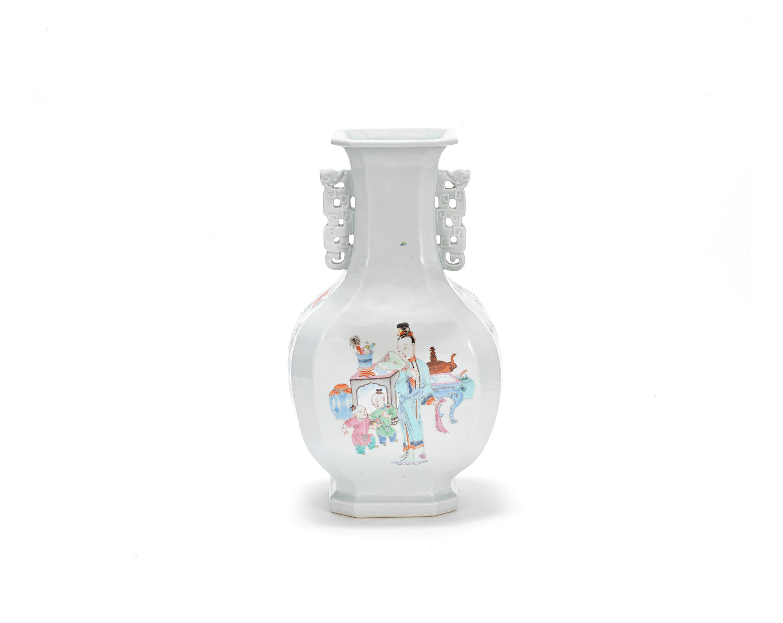 A famille-rose baluster vase, Yongzheng Painted with an elegant lady and boys in an interior amongst scholars' objects, the reverse with a river landscape, the sides respectively with flowering peonies and camellias.  44cm (17 1/4in) high. Estimate: £10,000-15,000