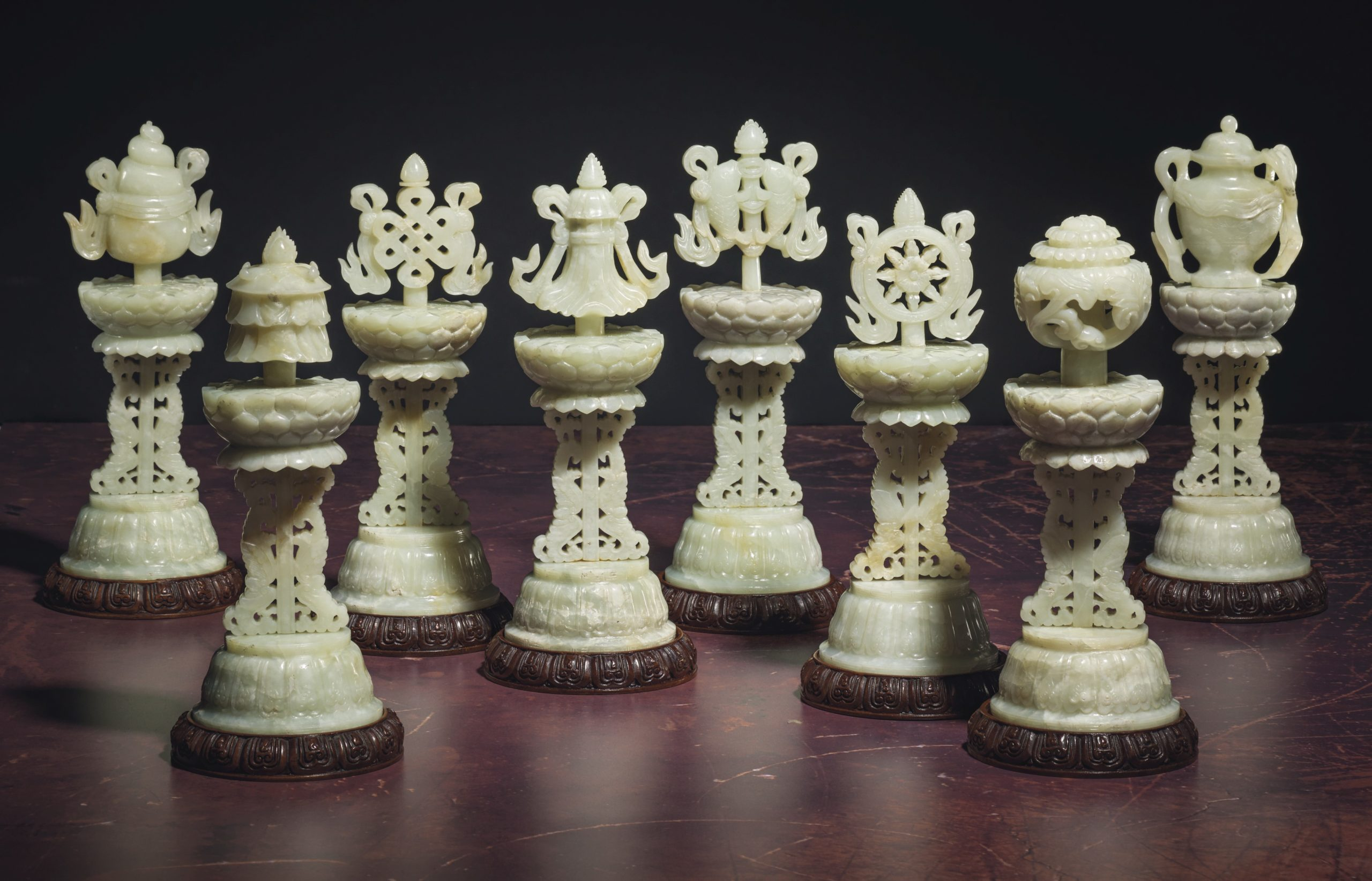 An Exceptionally Rare Complete Set of Pale Greenish-White Eight Buddhist Emblems, Bajixiang, 18th century, 9 7/8 in (25.1 cm.) high, £200,000-400,000