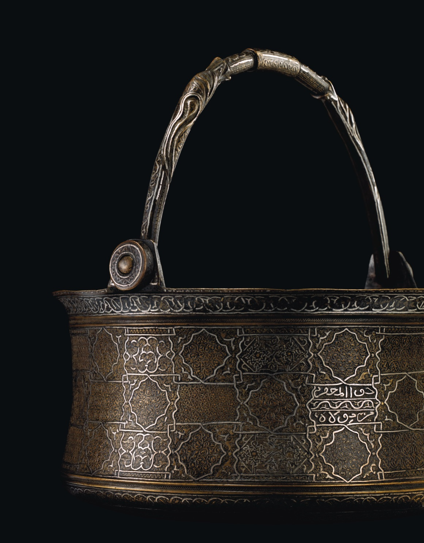 AN IMPORTANT 'VENETO-SARACENIC' BUCKET SIGNED BY THE CELEBRATED MASTER MAHMUD AL-KURDI