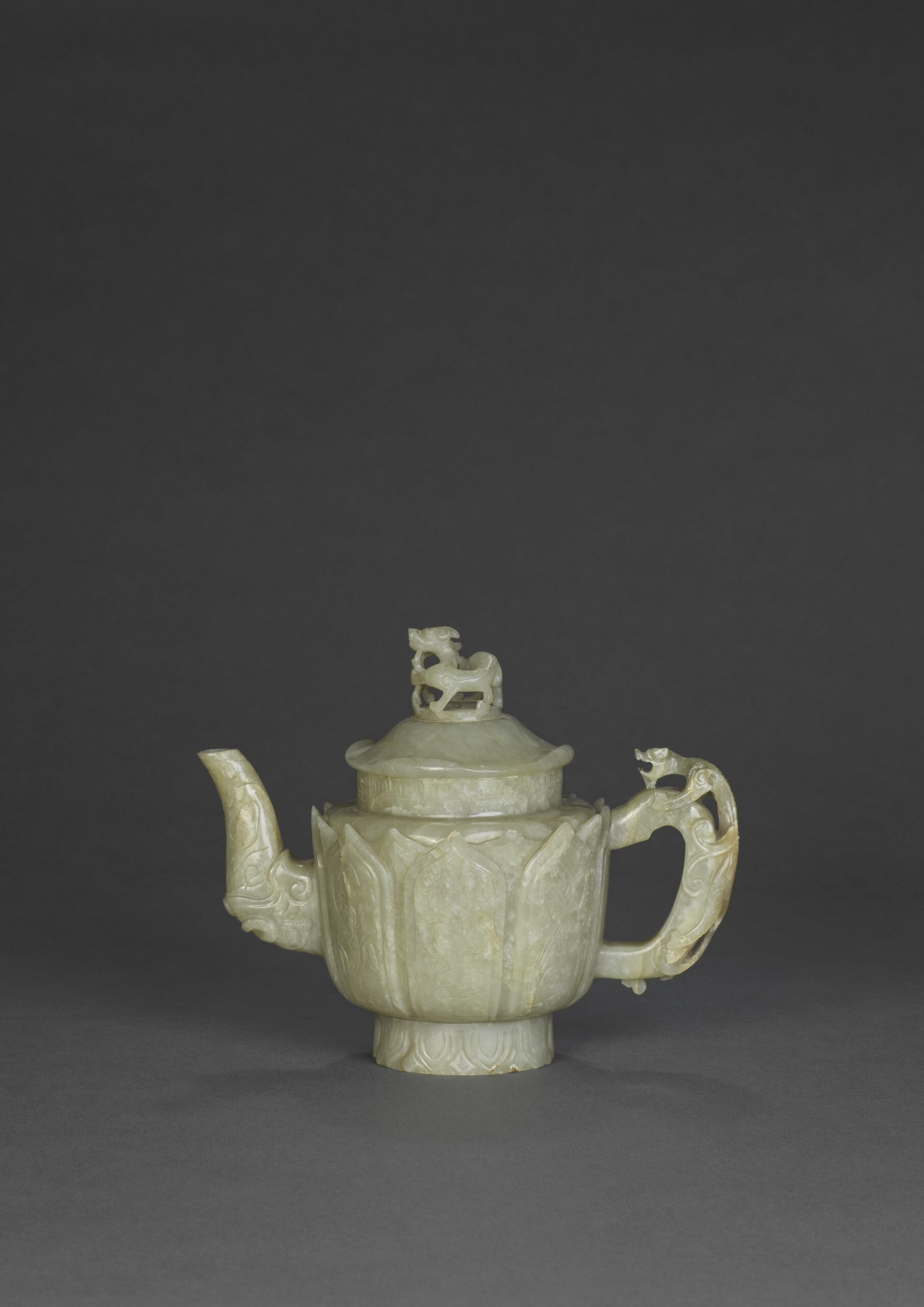 A light celadon jade lotus petal and poem ewer and cover