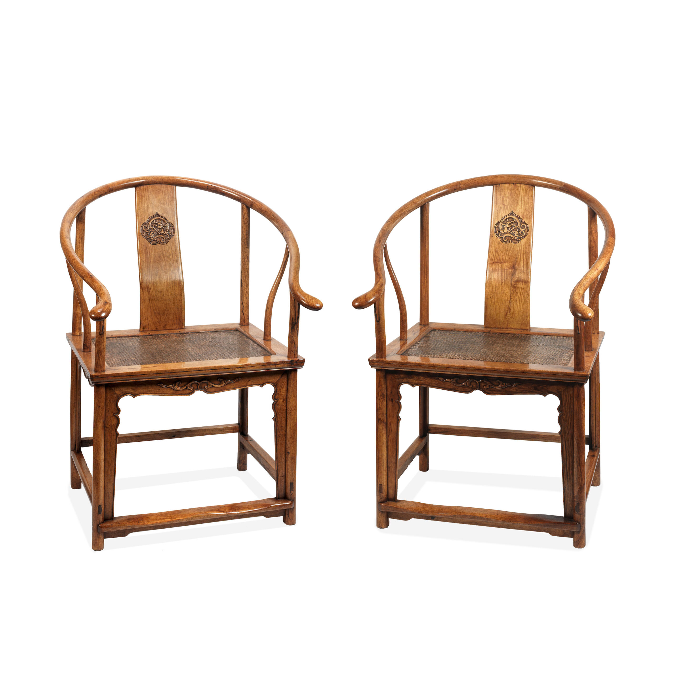 A PAIR OF HUANGHUALI HORSESHOE-BACK ARMCHAIRS, QUANYI | 101cm (40in) high x 61cm (24in) wide x 47cm (18 1/2in) deep | Provenance: A European private collection since circa 1980