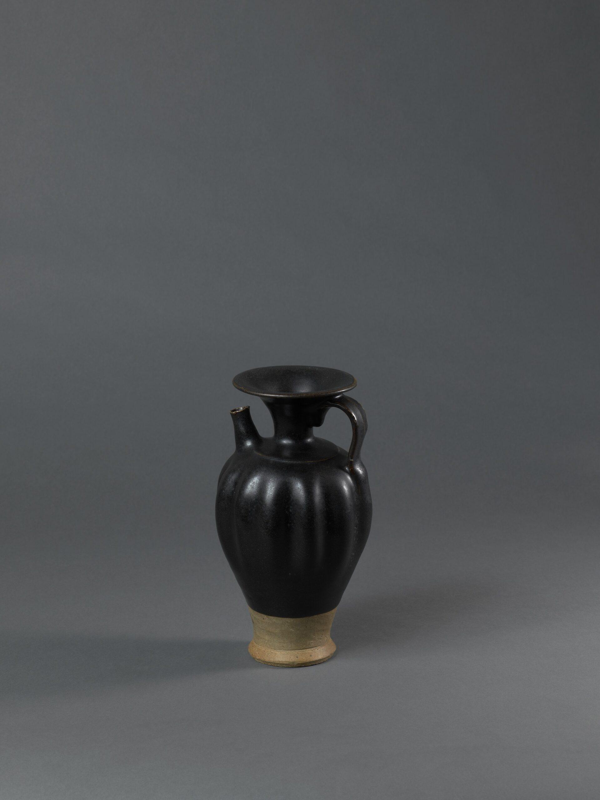 A Yaozhou black-glazed stoneware lobed ewer
