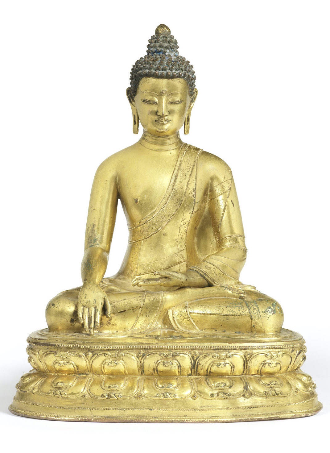 A VERY RARE GILT-BRONZE FIGURE OF BUDDHA SHAKYAMUNI, Tibet, 15th century, 27.5cm (10 7/8in) high. £120,000-150,000