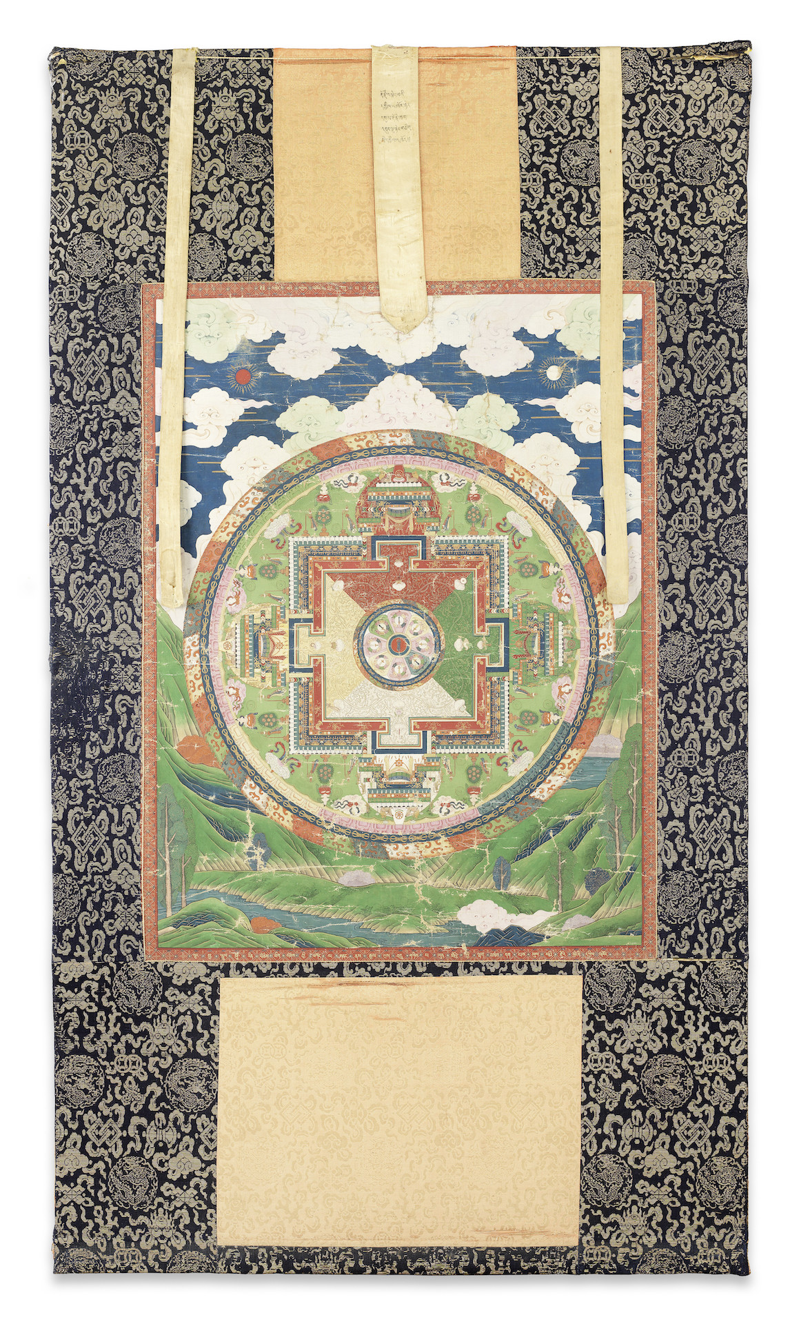 AN IMPERIAL INSCRIBED VAJRAHERUKA TWENTY-ONE DEITY MANDALA, Qianlong, circa 1750-1763, 74cm (29 1/8in) high x 55.5cm (21 7/8in) wide; With silk mounts: 134cm (52 6/8in) high x 75cm (29 1/2in) wide. £20,000-30,000