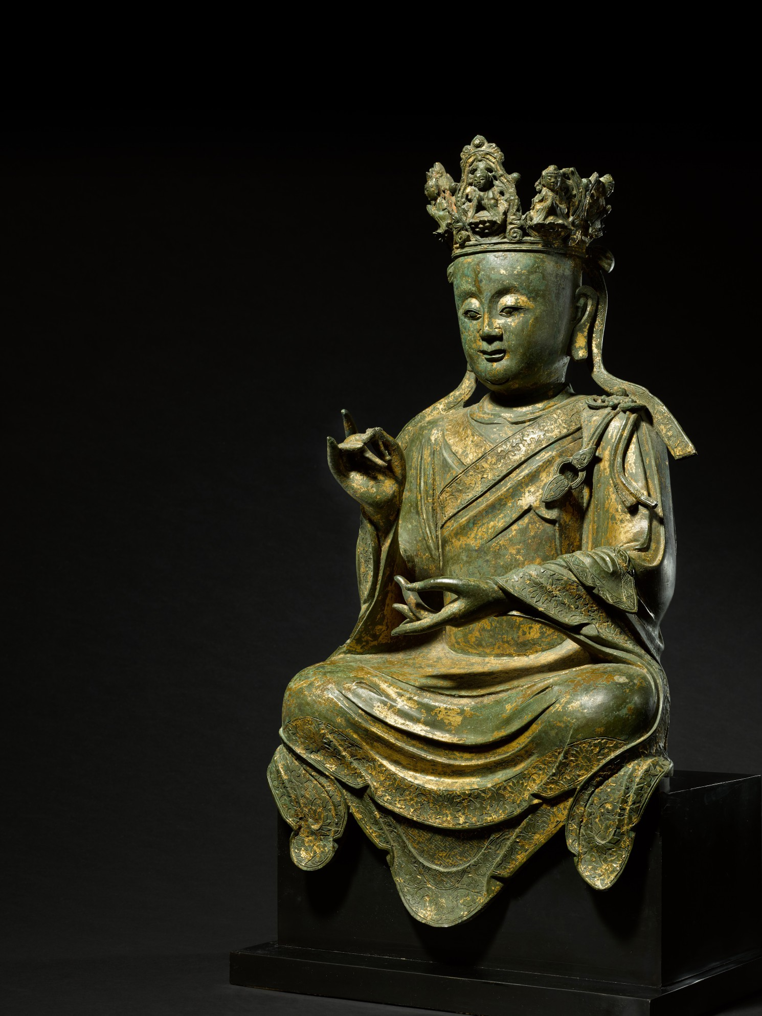 A large lacquer-gilt bronze figure of Guanyin, Ming dynasty