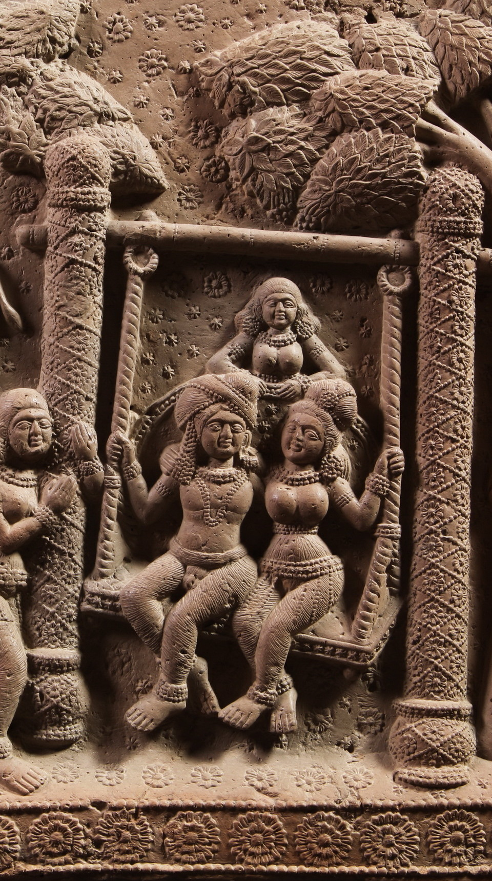 Plaque (detail) with a couple on a swing, Terracotta, Eastern India, Bengal, Chandraketugarh area, c. 1st century BCE, total height 39cm, total width 52cm