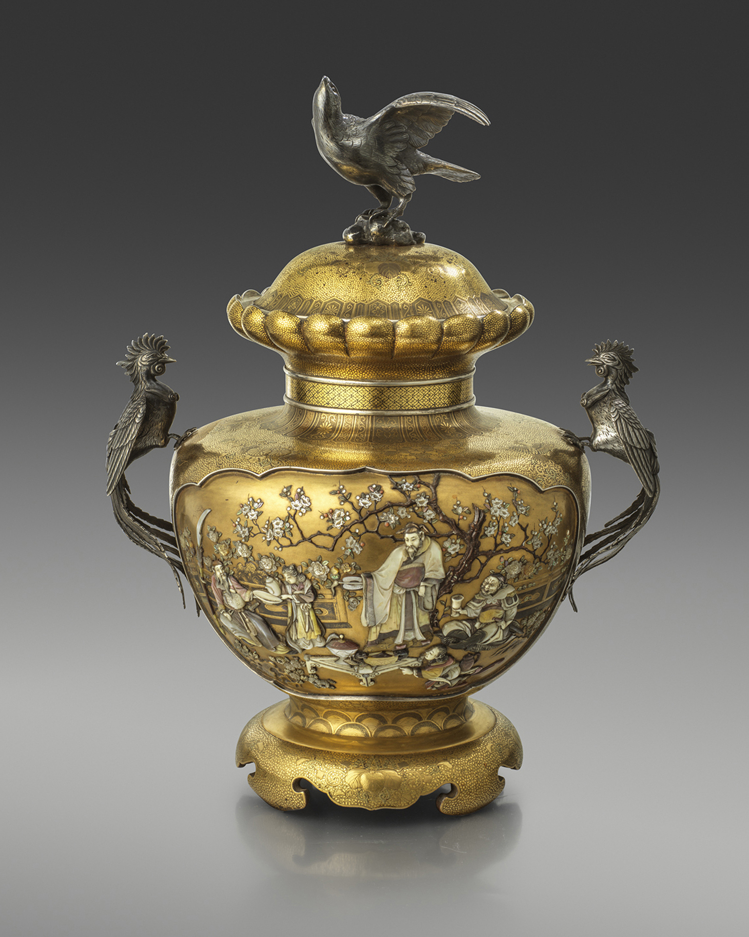 A large Shibayama vase and cover, finely worked with panels of The Three Heroes of Han, applied with silver ho-o handles and surmounted by an eagle finial. Signed on a mother of pearl tablet Harumasa, Meiji Period Circa 1890
