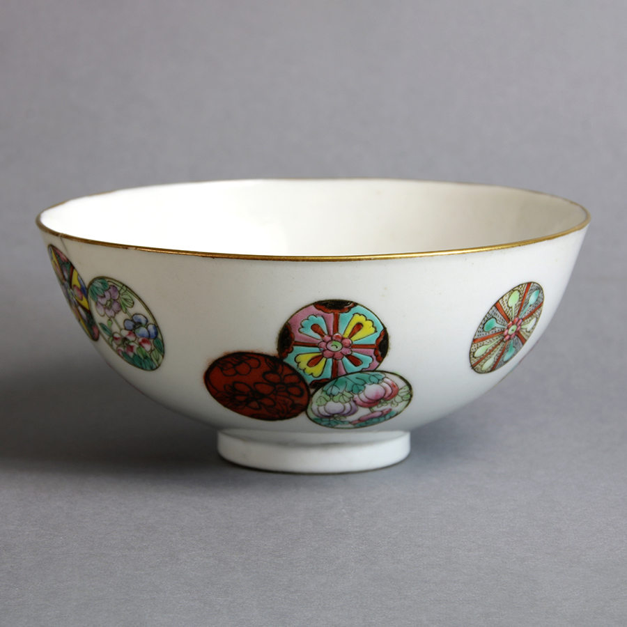 Of circular form, painted with scattered floral roundels, gilt rim, six-character Guangxu mark, 