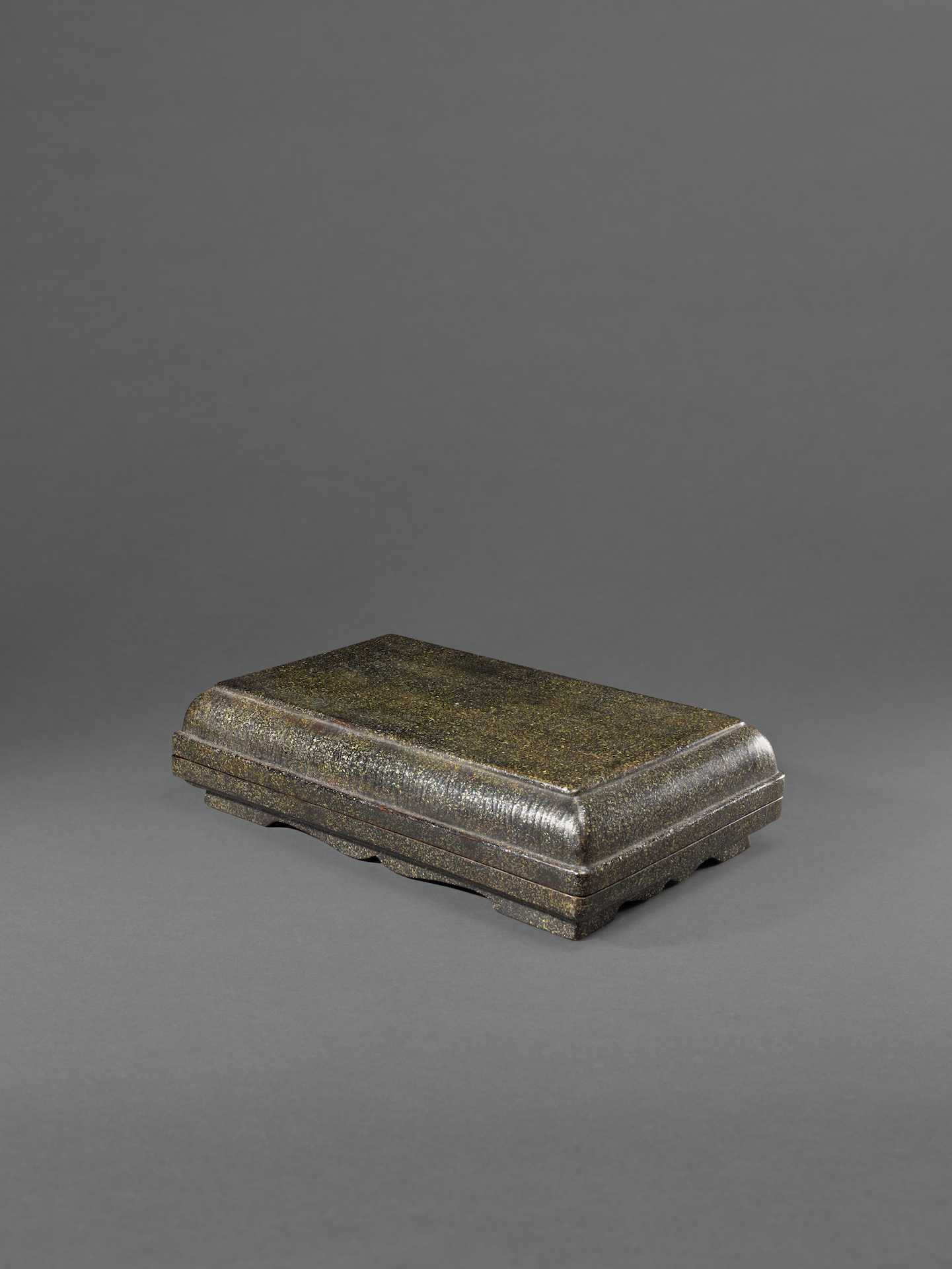 A BLACK LACQUER WITH CRUSHED MOTHER-OF-PEARL PRESENTATION BOX AND COVER  Ming dynasty (1368-1644),  16th century Length: 46 cm, 18 inches Width: 28.2 cm, 11⅛ inches Height: 11.5 cm, 4 ½ inches