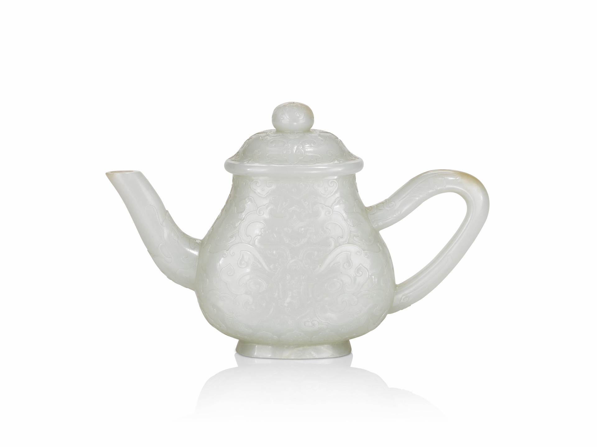 A rare pale celadon jade teapot and cover. Qing Dynasty, Qianlong period