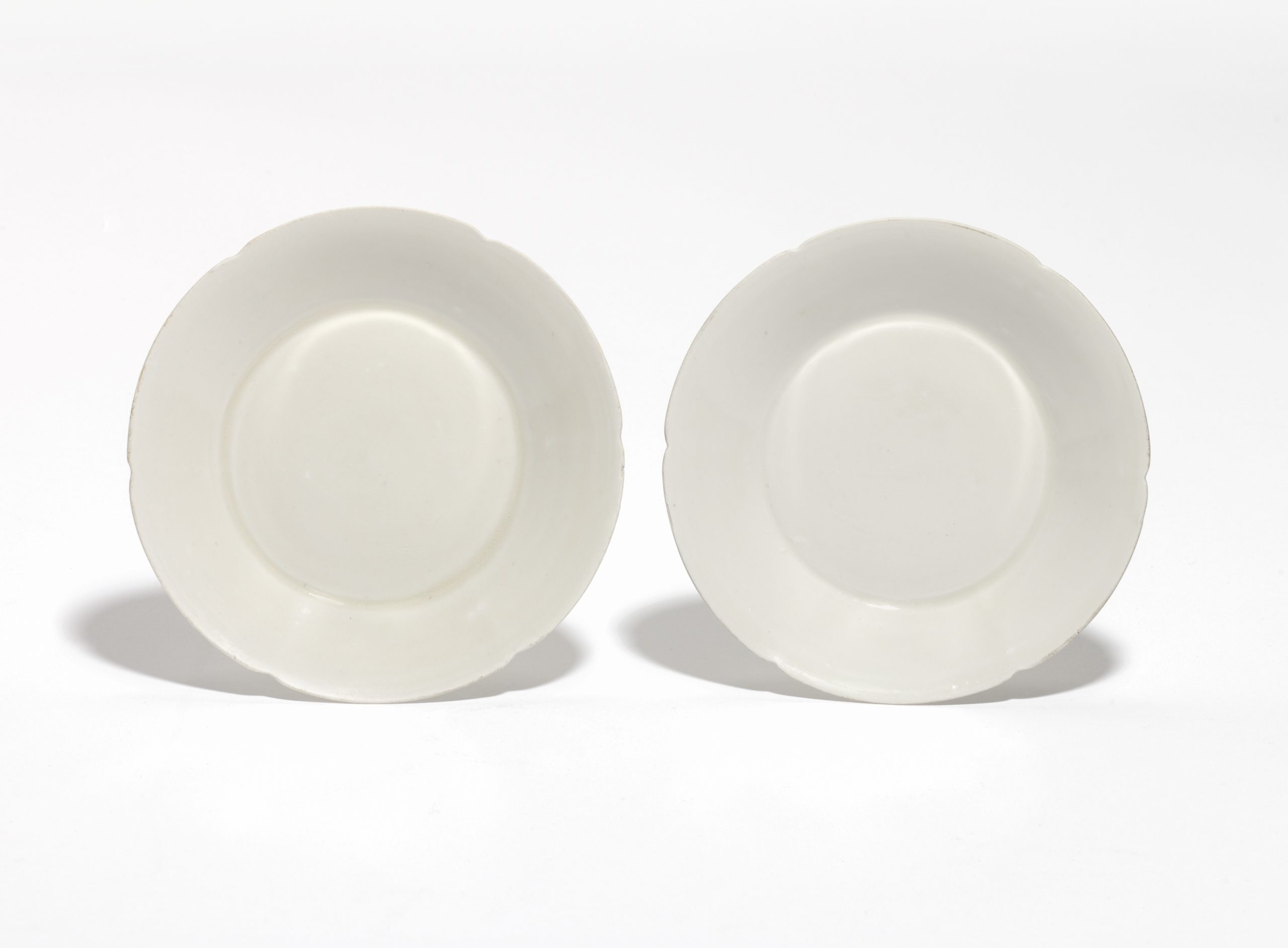 A pair of 'Ding' lobed dishes, Northern Song Dynasty, Dimensions: 13cm diameter