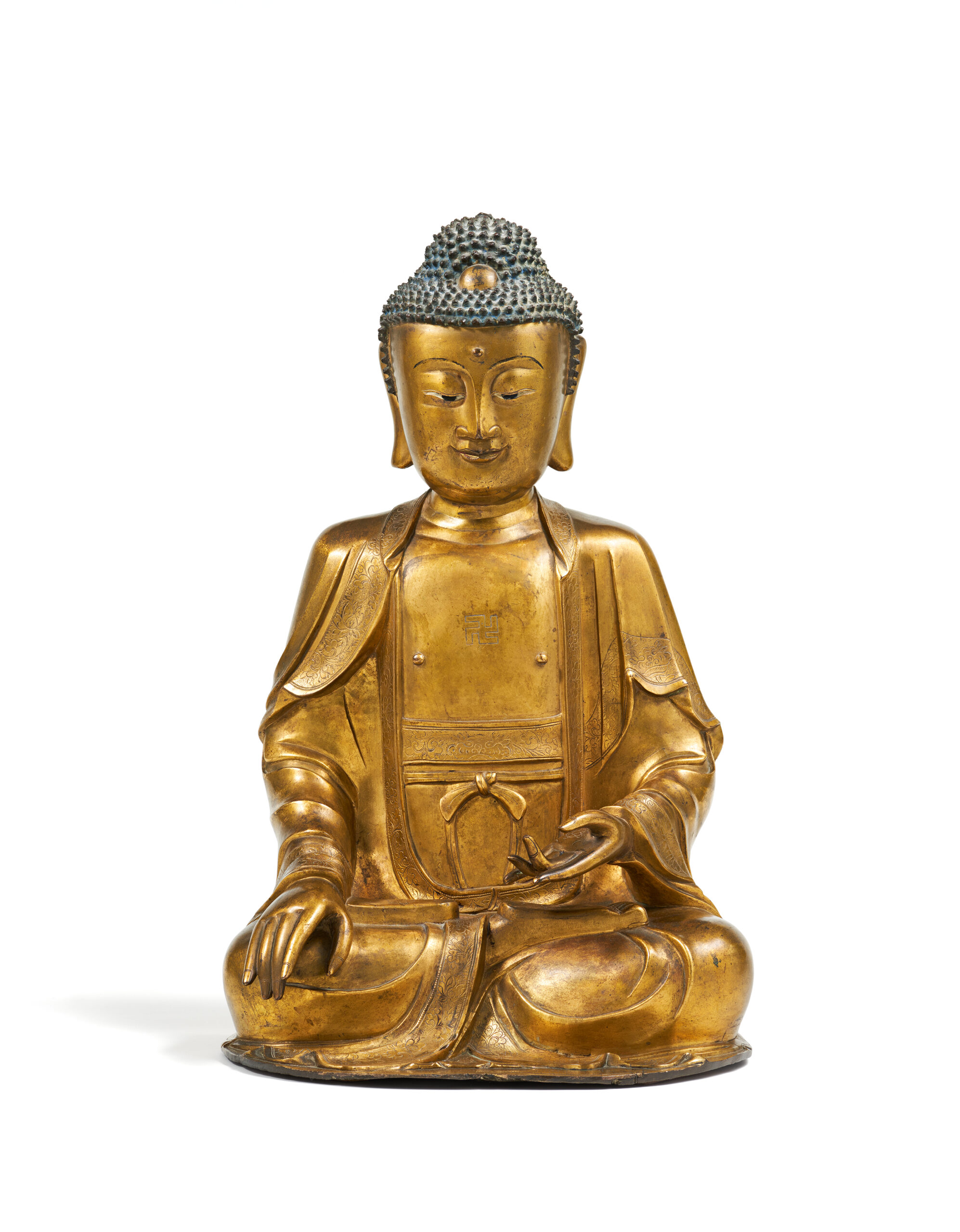 A LARGE GILT-BRONZE FIGURE OF SHAKYAMUNI 17th/18th century