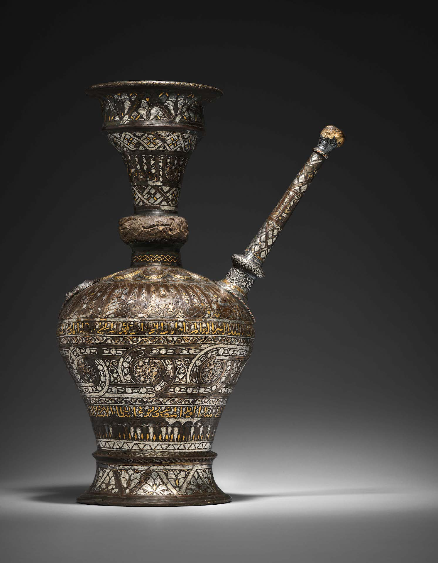 AN EXTREMELY RARE SILVER AND GOLD-INLAID MAMLUK EWER FROM THE PERIOD OF SULTAN AL- MALIK AL-NASIR MUHAMMAD IBN QALAWUN, 47.5cm height £200,000-300,000