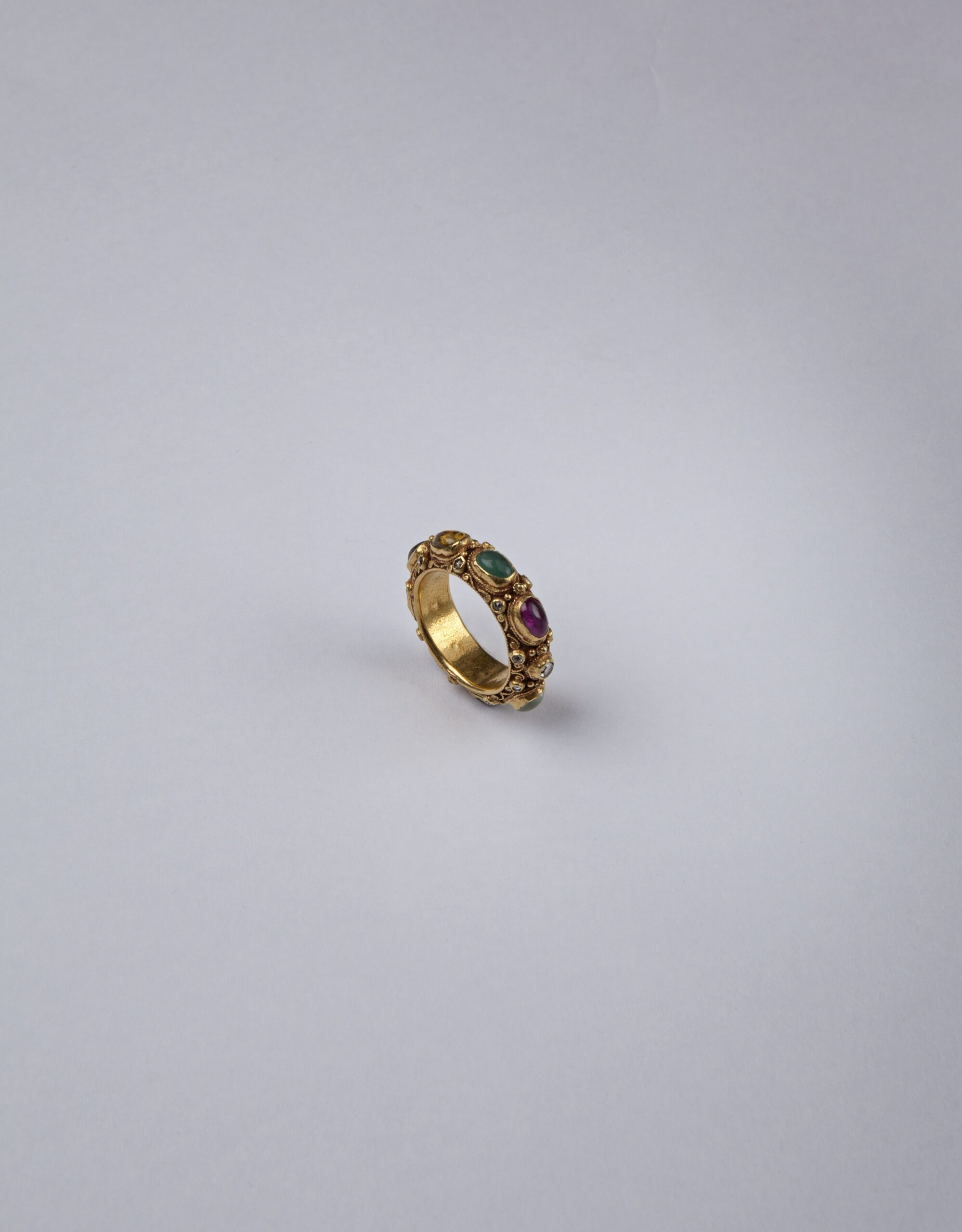 A GEM-SET GOLD NINE PLANET RING, THAILAND, RATTANAKOSIN PERIOD 19TH/20TH CENTURY