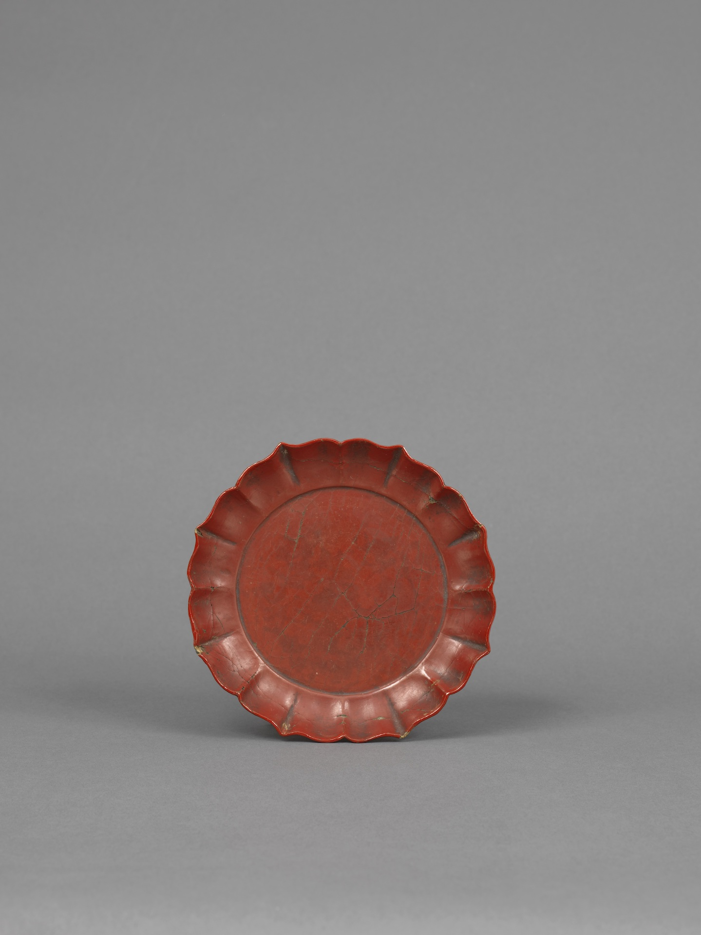 A RED LACQUER EIGHT-PETALLED FLOWER-SHAPED SMALL DISH  Southern Song dynasty (1127-1279) or Yuan dynasty (1279-1368) Diameter: 14.2 cm, 5½ inches