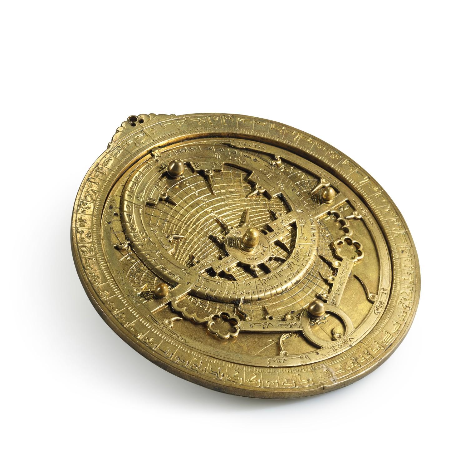 A unique gilt-brass astrolabe signed by Ahmad ibn Abu abd Allah al-Qurtubi al-Yamani