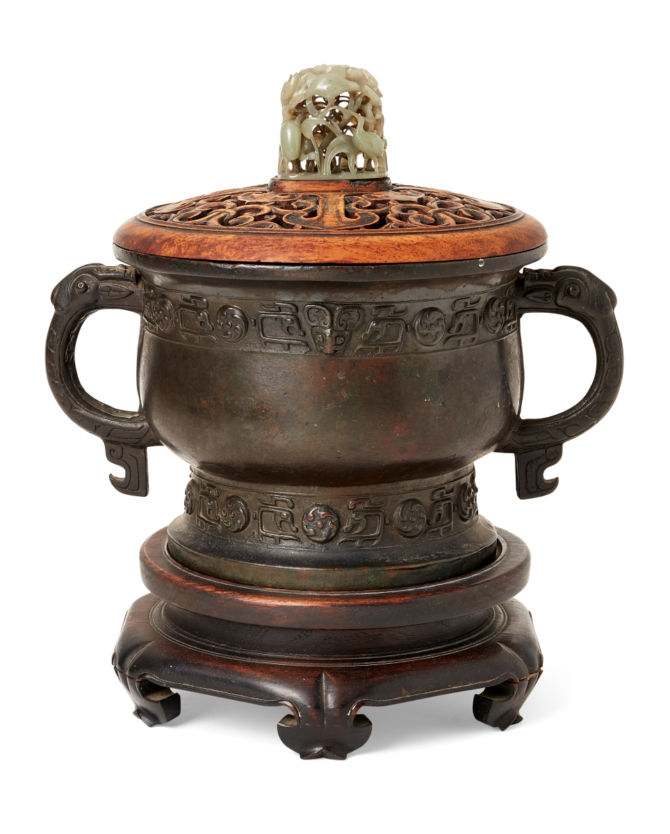A Chinese bronze censer, Ming dynasty, with carved wood cover and jade finial
