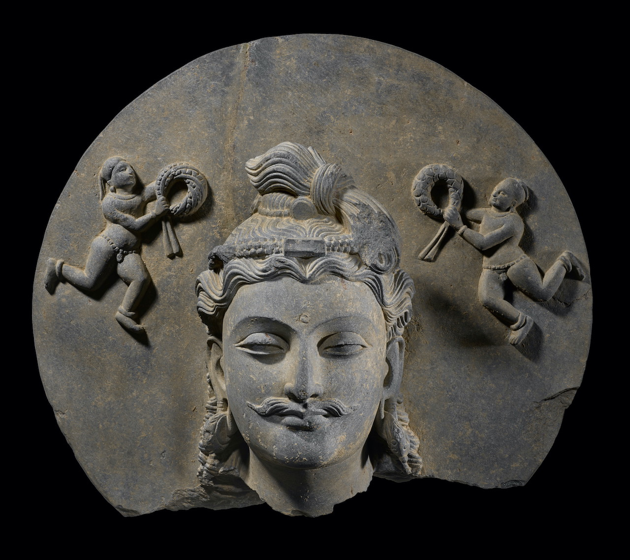 A stunning head of the Future Buddha, Maitreya, dates from the 3rd/4th century