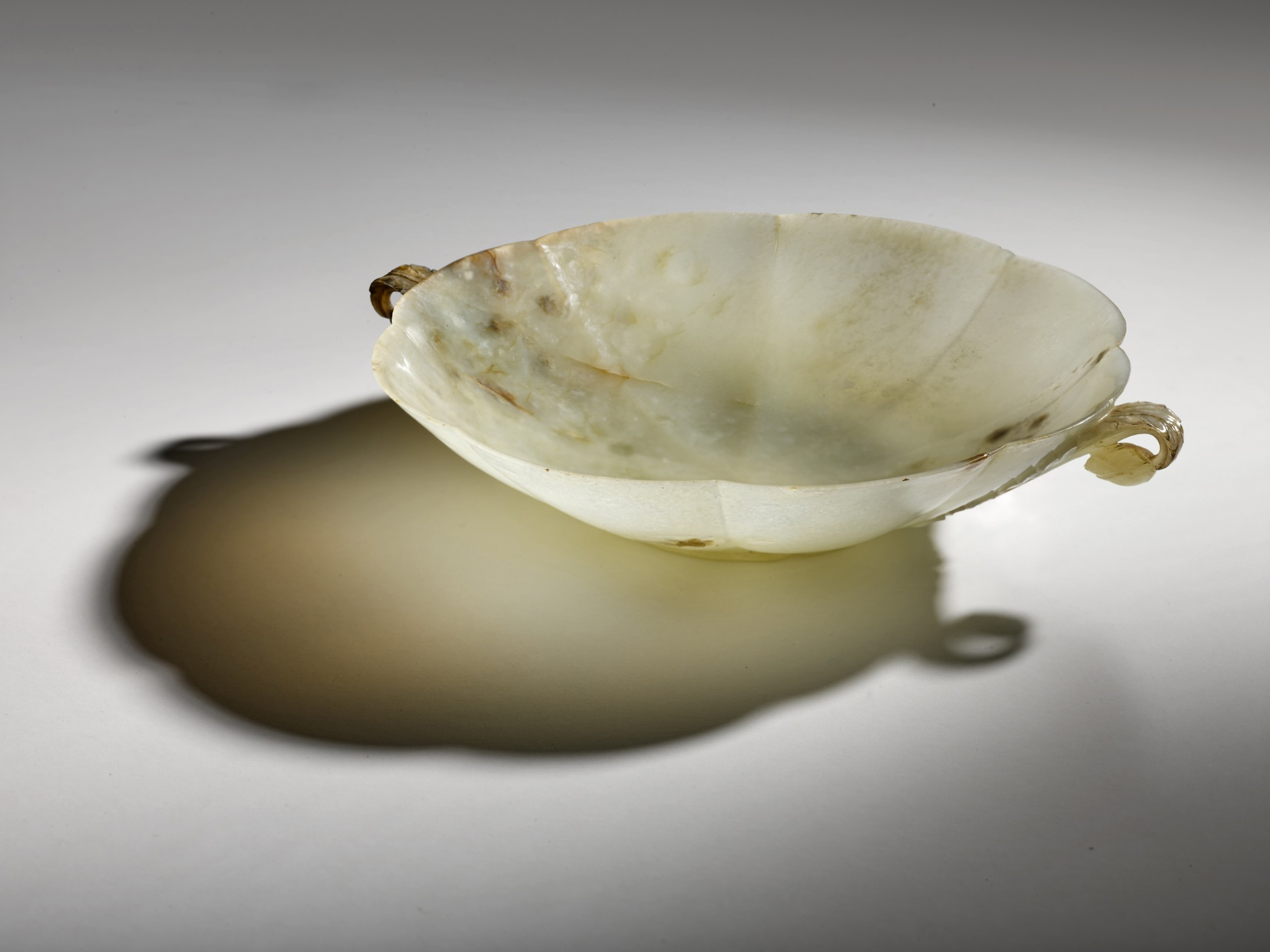 An important large Mughal carved jade bowl, India, 17th/18th century
