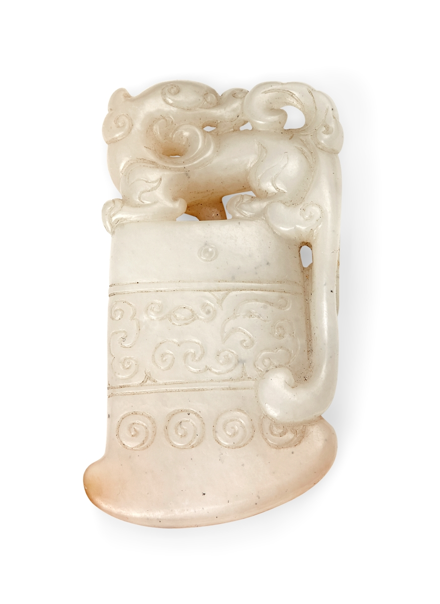 A Chinese white and russet jade axe-form pendant, 18th century