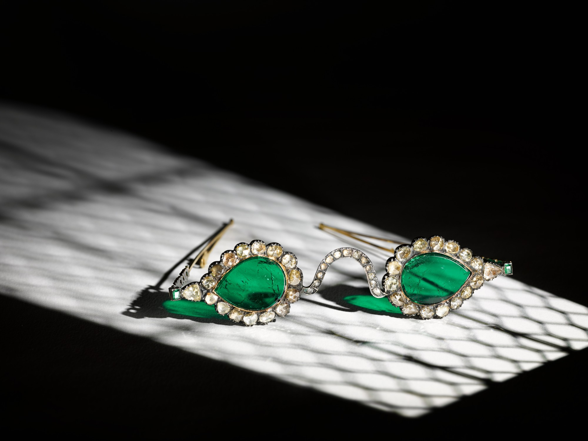 A pair of Mughal spectacles set with emerald lenses, in diamond-mounted frames, India, lenses circa 17th century, frames 19th century