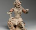 Rare Chinese pottery seated lokapala Tang dynasty (618-907) Height: 30cm, 12 in.
