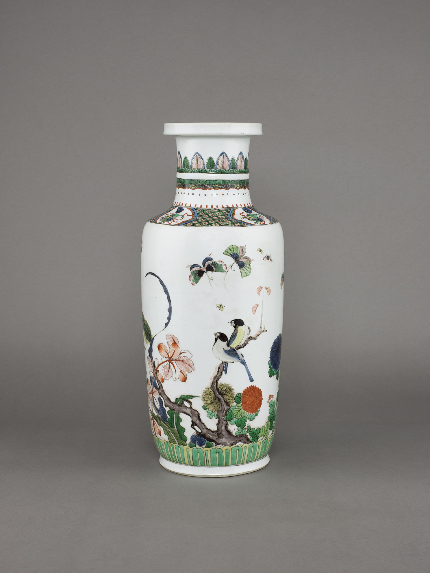 no. 12 - Chinese porcelain famille verte, wucai vase of rouleau form, painted with two birds on a branch amongst flowers, butterflies, dragonflies and other insects. 18 ¾ inches, 47.6 cm high. Kangxi, 1662-1722.