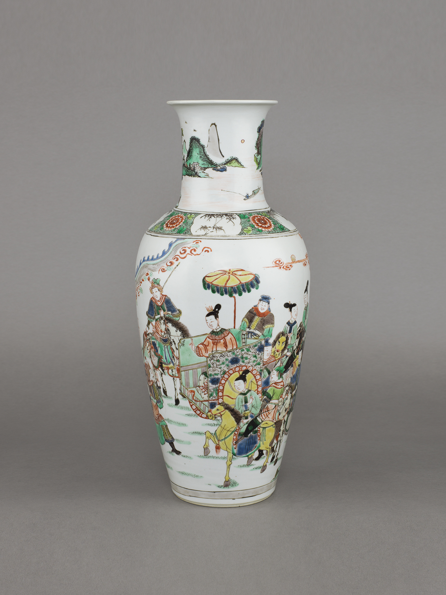 no. 10 - Chinese porcelain famille verte, wucai baluster vase of tapered form, with a lady in a sedan chair amongst all her attendants with a warrior and scholar, meeting two kneeling soldiers. 17 ¼ inches, 43.8 cm high. Kangxi, 1662-1722.