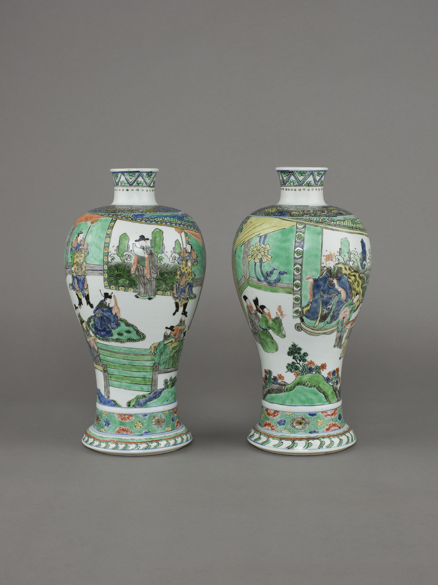 no.8 - Pair of Chinese porcelain famille verte, wucai dated vases of meiping form, each painted with a scene of a provincial governor being reassigned and departing to his assigned post. 12 inches, 30.5 cm high. The bases with four-character marks, xinsi nian zhi, in underglaze blue within a double ring and of the period, corresponding to the xinsi year, 1701.