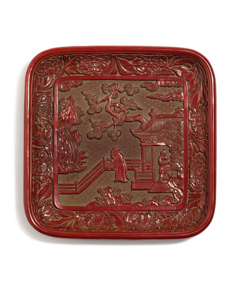A rare and finely carved cinnabar lacquer 'figural' tray Ming dynasty, 15th century