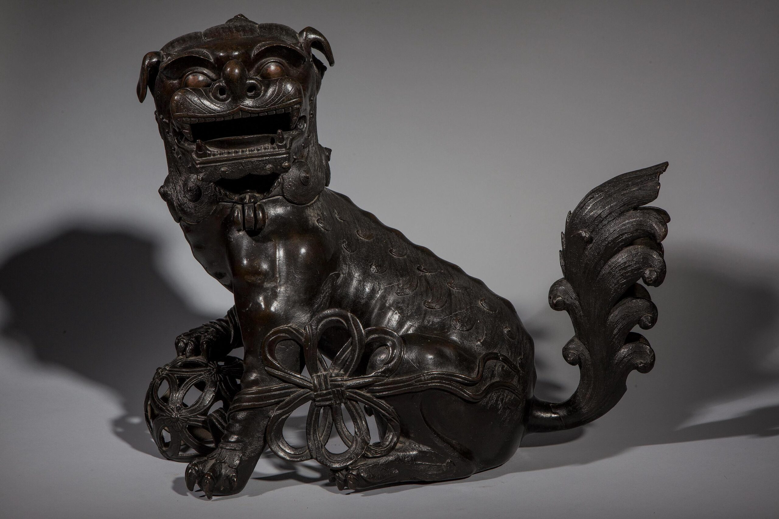 Bronze Buddhist Guardian Lion China, late Ming Dynasty, c. 1600 17 1/4 x 22 in (44 x 56 cm)