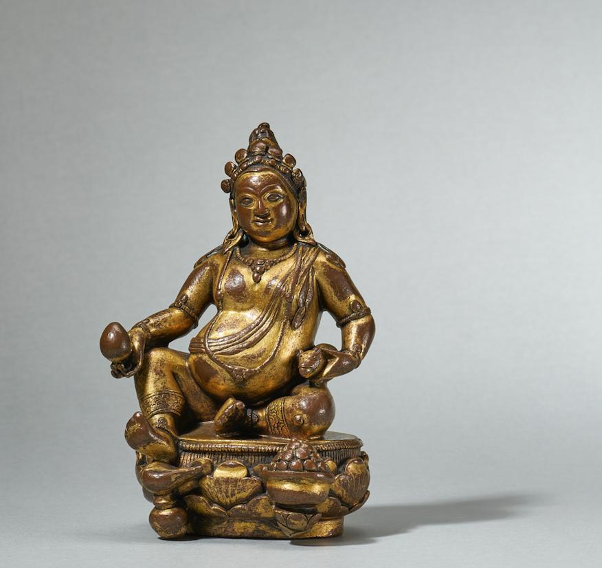A gilt-bronze figure of Jambhala, 16-17th Century