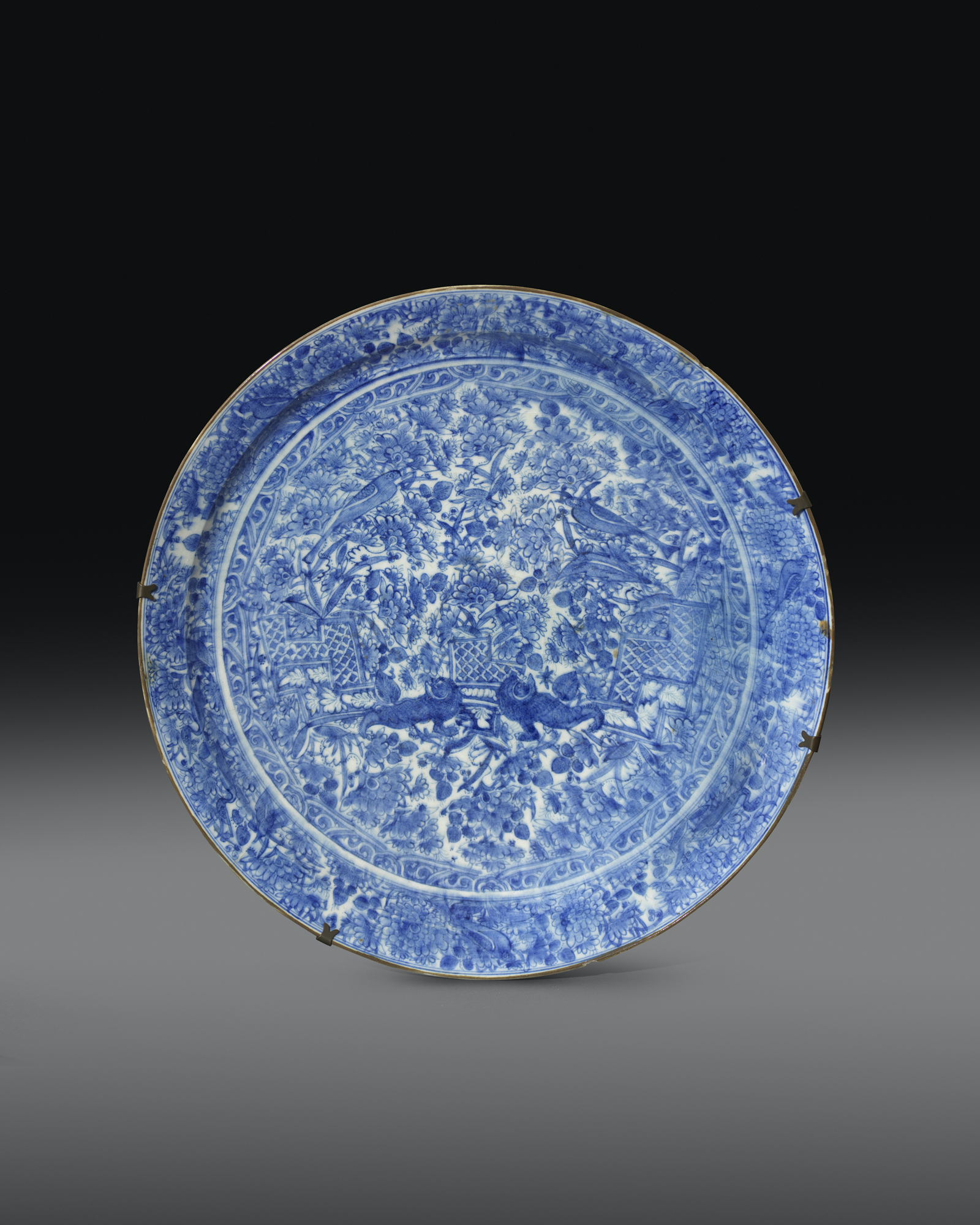 FORGE & LYNCH A large Safavid blue and white pottery dish Persia, late seventeenth century 53.8 cm. diameter; 10.6 cm. height