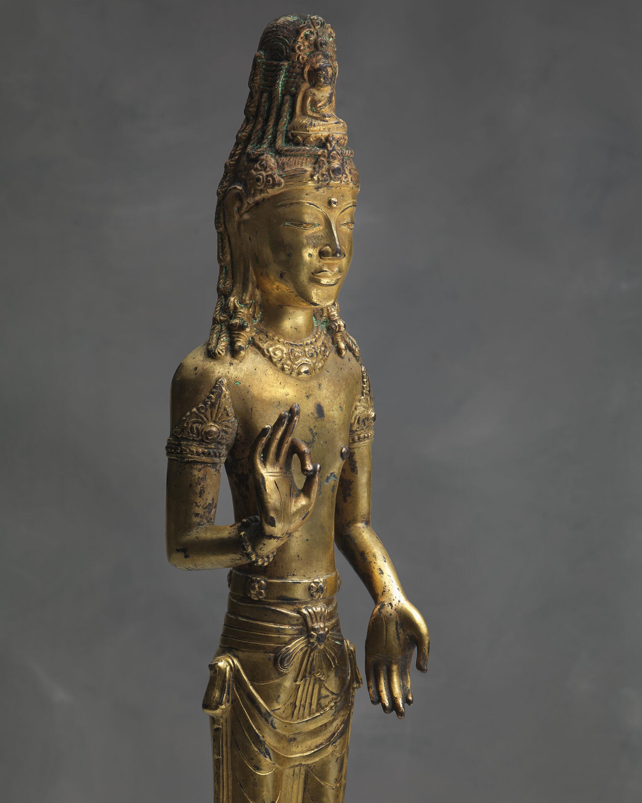 ESKENAZI LTD. A Gilt-bronze Standing Figure of an Acuoye Guanyin Yunnan, Dali Kingdom, 12th century Height: 45.7cm