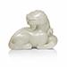 A rare white jade figure of a buddhist lion