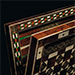 A LARGE CERTOSINA WOOD AND IVORY-INLAID GAMES BOARD