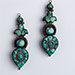 A PAIR OF SILVER AND TURQUOISE EARPIECES (Akor) Lhasa, Tibet, 19th Century