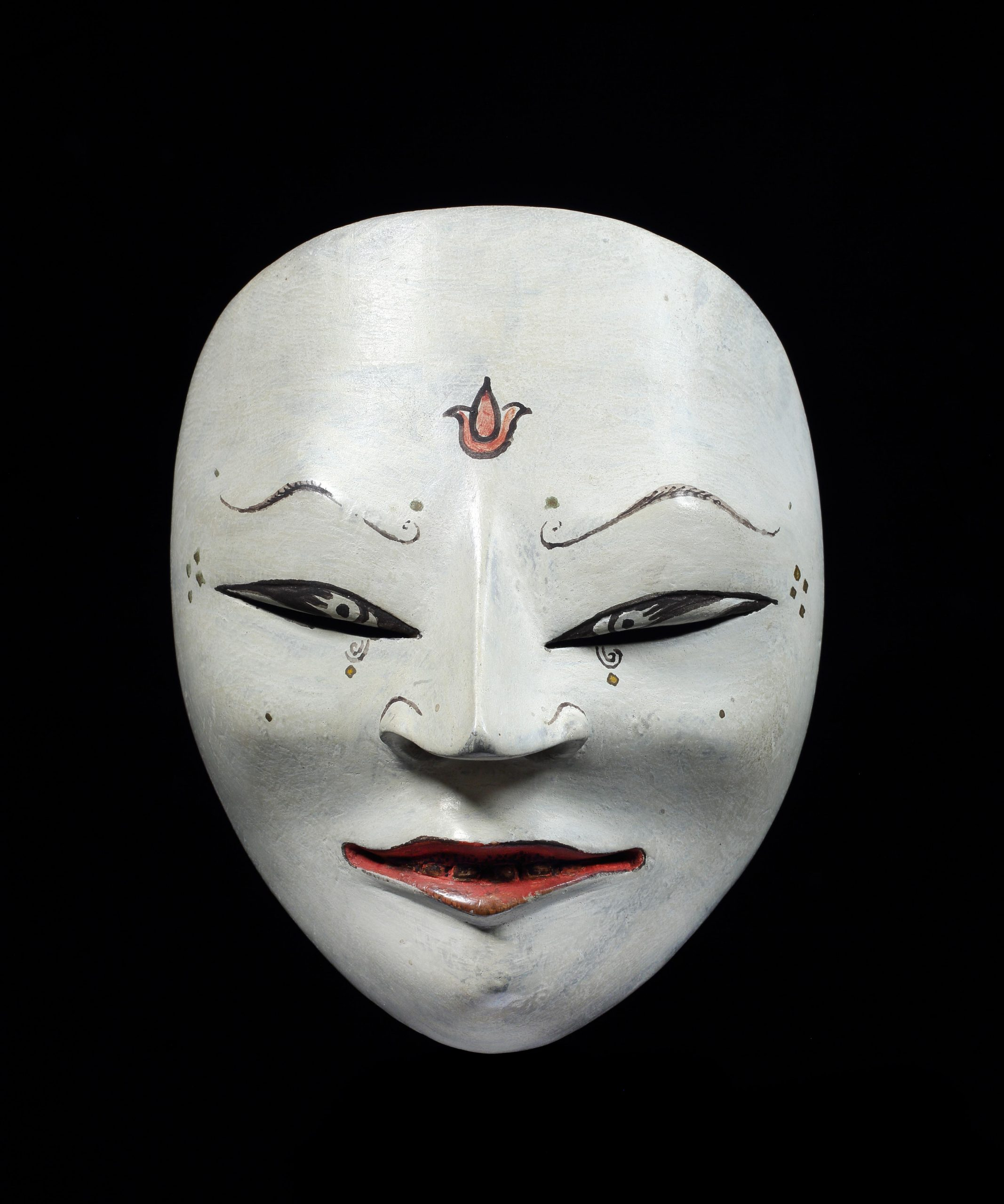 A Javanese theatrical mask, 'topeng', from Cirebon. Late 19th or early 20th century, 18cm high