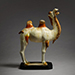 A magnificent amber and straw-glazed pottery figure of a Bactrian camel, Tang Dynasty