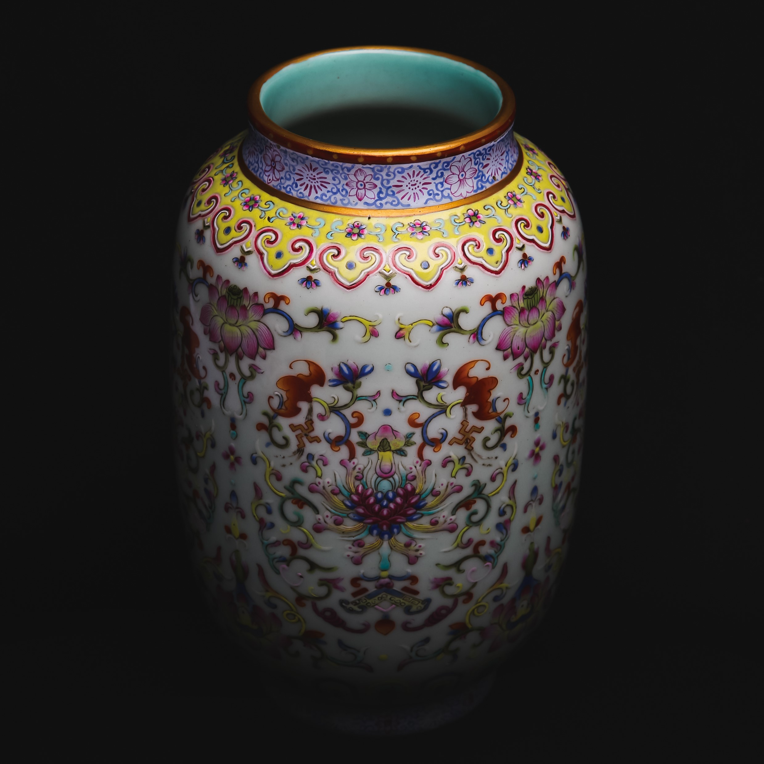 Sold for £12,500 Including Buyer's Premium. A Chinese famille rose lantern 'lotus' vase. Qing Dynasty, Qianlong mark and of the period.
